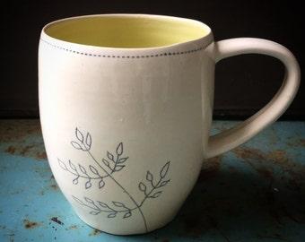 Mug with plant sketch