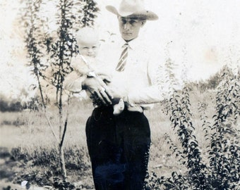 vintage photo 1920 Handsome young Cowboy Dad Holds Baby by Tree