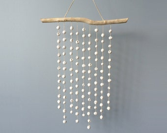 Gumnut wall hanging. A white cast plaster wall piece handmade in Australia by Kuberstore