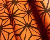 Barkcloth Asanoha orange and black hemp leaf stars traditional Japanese design from Westex