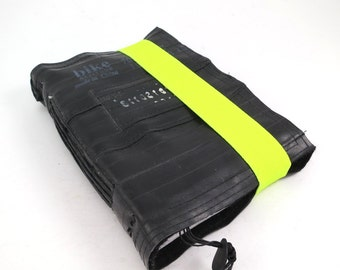 Journal, recycled bicycle inner tube, handmade blank, medium. Elastic neon yellow closure.