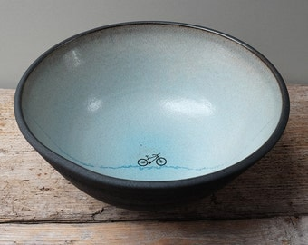Large Black Ceramic Bowl with Turquoise Glaze and Mountain Bike