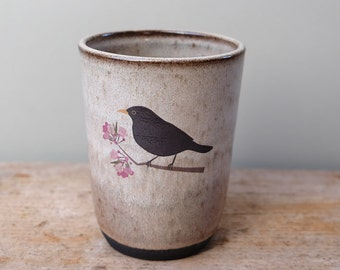 Tall Black Ceramic Cup with Grey Glaze and Blackbird on Blossom Branch