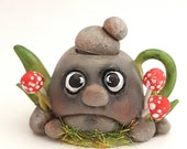 1:12 scale fantasy stone with face teapot.