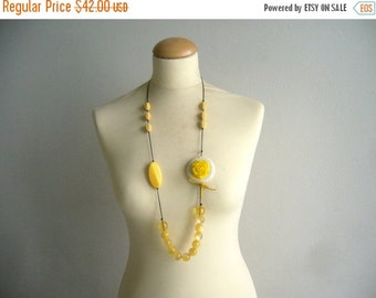 Yellow necklace. yellow rose