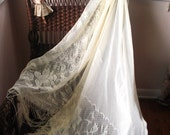 Wedding vintage 7o off white polyester, lace, oversize , triangle shawl with a folk flowers print and fringe.
