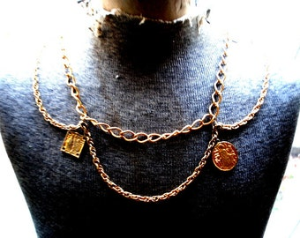 Exotic vintage 70s , gold tone textured metal belt-necklace with a drapery  and egyptian motive pendants- medalions.