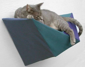 Cat shelf wall bed in deep teal, blue and navy