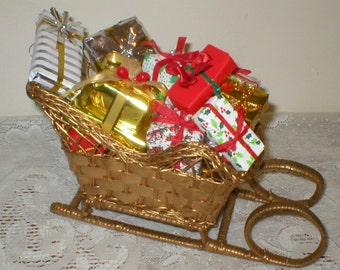 Santa Wicker Sleigh Filled With Wrapped Mini Christmas gift boxes packages Presents Vintage