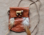 Leather necklace pouch with ceramic cougar bead, rooster feathers and braided cords for crystals, herbs, medicine, more