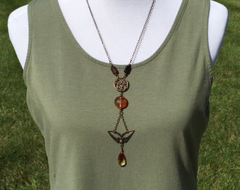 Long Necklace with topaz colors, Soaring bird, and Teardrop Crystal