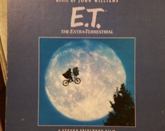 E.T. vinyl record soundtrack narrated by Michael Jackson with illustrated story book.