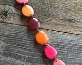Bracelet in pinks, oranges, reds