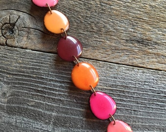 Bracelet in pinks, oranges, reds