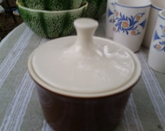 brown and cream covered sugar bowl