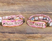 Music Heals Triple Strand Bracelet inspirational phrase words saying inspiration musical boho orchid purple pink song musician quote