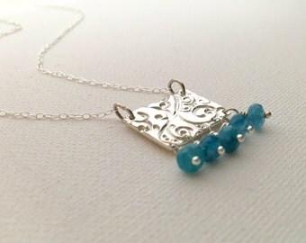Blue Quartz beads on a handmade PMC pendant.