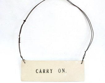 carry on   ...   hanging porcelain sign