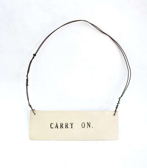 carry on   ...   hanging porcelain sign