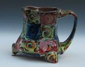 squared and circled footed mug with big ergonomic handle