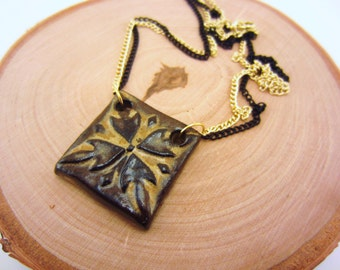 Clay necklace. Ceramic jewelry, black and tan pendant. Glazed ceramic. Gold and black double chain. Square pendant. Geometric necklace.