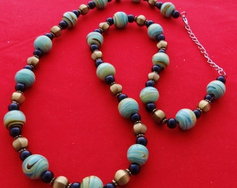 "Vintage  26"" necklace with swirled turquoise all glass beads in great condition"