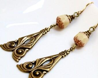 cream glass and brass Filigree drop earrings,  glass and brass earrings, vintaj brass drop, oxidized brass earrings
