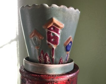 Vintage pottery planter with birdhouses