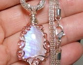Moonstone drop cabochon pendant, natural stone from India, hand wrapped silver and rose filigree setting