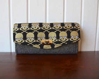 Necessary Clutch Wallet in Gold metallic skulls with Black Essex linen with metallic gold