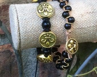 Fleur de lis and black bead bracelets