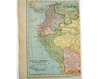 South America vintage  paper map from the 1923.   Colombia, Madagascar on back.  Pastel colors  original paper travel ephemera.