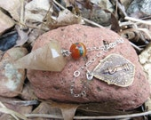Rutilated Quartz pendulum on a Sterling chain Copper Buddha pendant on the end