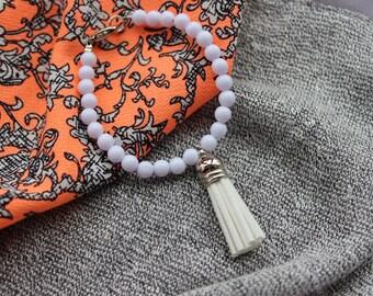 White Beaded Tassel Bracelet.