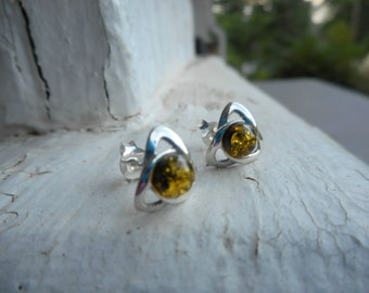 The Eyes of Ra Golden Baltic Amber and sterling silver cast metal valknut earrings. Stud earrings post earrings