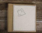 handmade linen album with hand-embroidered wool felt patch: bird by kata golda