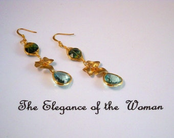 Wire wrapped connector which flows into a Cascading orchid flower, and Erinite glass pendant polished in gold plated framed earrings. ER0004