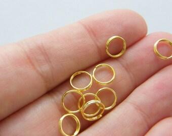 200 Split rings 7mm gold tone
