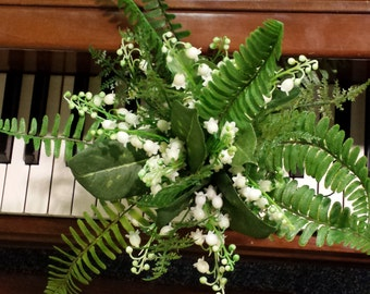 Bridesmaids or toss bouquet made with lily of the valley and ferns