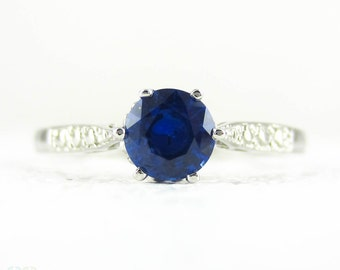 Sapphire Engagement Ring in Vintage Style Platinum Setting, 0.52 ct Round Cut Blue Sapphire in Engraved Beaded Platinum Setting.