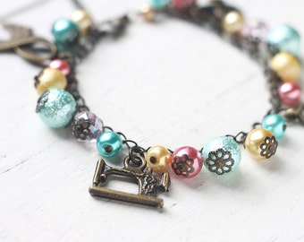 Tailor Charm Bracelet Antique Brass Bracelet - Sewing Themed Bracelet with Pastel Blue, Mint Green, Yellow and Pink