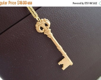 Vintage brass skeleton key charm necklace