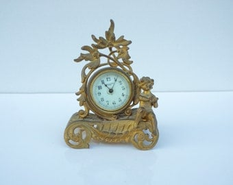 Antique Art Nouveau Boudoir Clock New Haven Gilt Metal With Cherub And Porcelain Dial Charming