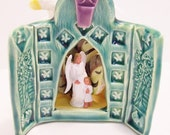 Ceramic turquoise church  with angel