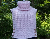 Hand crocheted pink Aura turtleneck pullover sleeveless sweater with wooden buttons and custom stitching