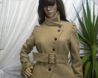 Elegant women's coat with asymmetrical fastening belt made of woolen textiles