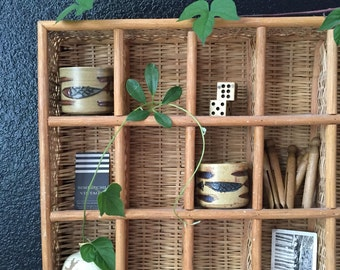 vintage woven rattan bamboo wall hanging shelf / curio display