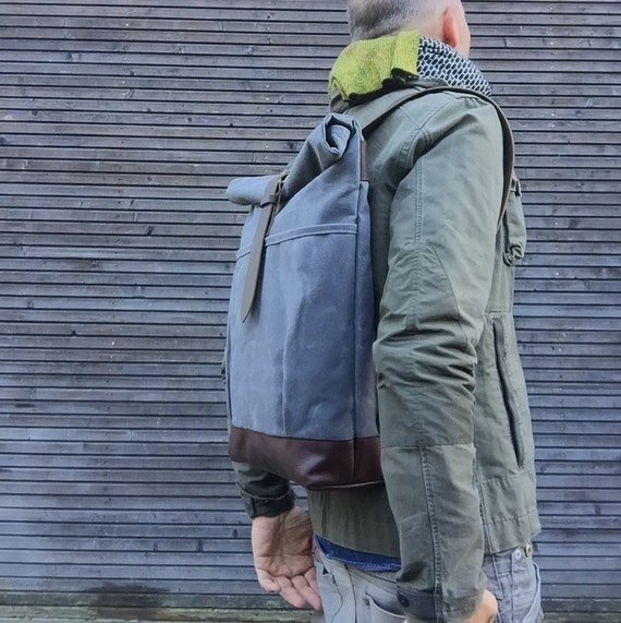 Waxed canvas rucksack / backpack with roll up top and leather shoulderstrap,handle and leather bottem COLLECTION UNISEX