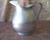 Vintage silver aluminum pitcher.   B351-.50