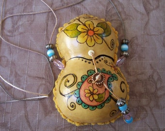 Gourd medicine bag necklace flowers and paisleys front. 1848.